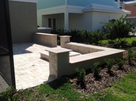 Landscape travertine fire pit patio design installation irrigation mulch sod pavers DeLand Sanford Palm coast