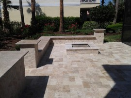 Brick paver patio Deland Sandford Palm Coast fire pit natural stone travertine installation design