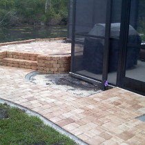 Raised patio with retaining wall and pave walkway Deland Sanford Palm Coast
