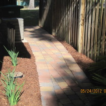 Brick paver sidewalk and planting with mucl Deland Sanford Palm Coast