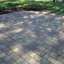 Brick paver patio with plants sod mulch Deland Sanford Palm Coast