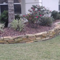 Natural stone plant boarder Deland Sanford Palm Coast