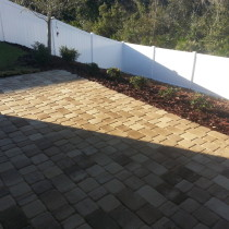 paver patio with landscape plants by design deland sanford palm coast