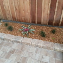 Paver patio and wall river rock and plantings deland snaford palm coast